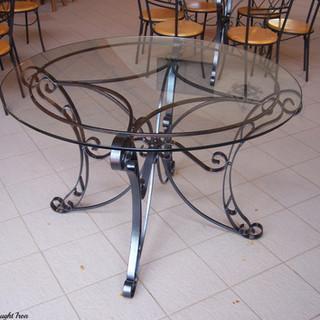 Big Barell Maleny  Dining table 1 0f 4 Features an 8mm thick glass top seating 6-8 people.