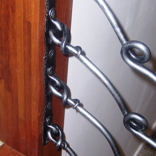 """""""Free form"""" wrought iron balustrade shackle and rivet fixings."""