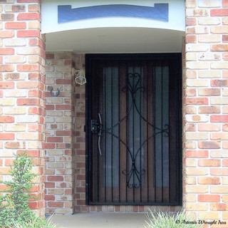 """A """"Contemporary"""" 4 sided scroll design wrought iron security door."""