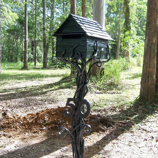 "The ""Sleepy hollow"" mailbox. Features include roof rivets, fully textured walls, and forged vines supporting the mailbox."
