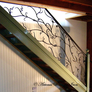 """""""Sweeping vine"""" wrought iron balustrade featuring fine detailed vine wrapping with elegant scrolls and flowing lines."""
