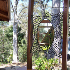 """Spider webb""  A commissioned wrought iron outdoor mirror frame."