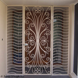 "An ""Art Deco"" wrought iron security entrance with side panels."