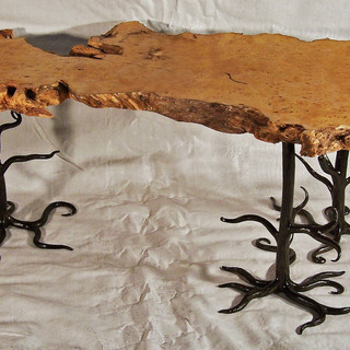 """""""Gumtree""""  Coffee table  Features include a """"silky oak"""" slab top with natural edges complemented with wrought iron legs and frame reminiscent of the """"silky oak"""" root system including forged limbs and branches."""