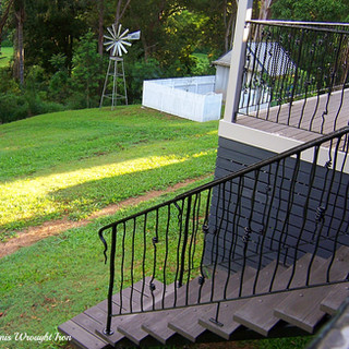 """""""Free form""""  wrought iron staircase balustrade."""
