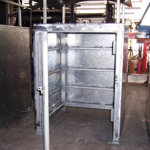 Rubbish bin lockable access door.