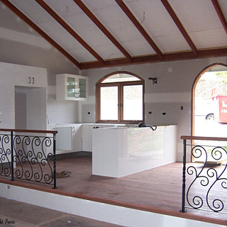 """Mexican"""" inspired w""""rought iron balustrade with quila top rail."""