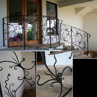 """""""Abstract' wrought iron balustrade features non redundant lines and shapes filling the spaces."""