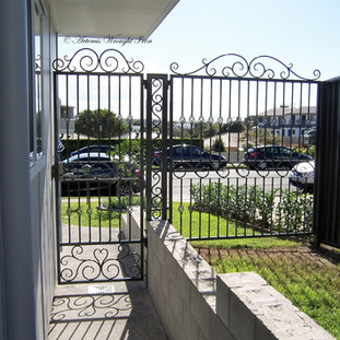 """""""Contemporary"""" laneway access gates with central support column."""