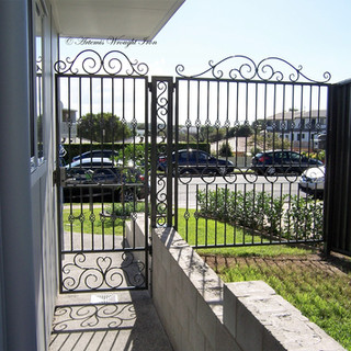 """Contemporary"" laneway access gates with central support column."