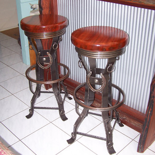 """""""Giddy up"""" bar stools Features includes solid timber slab seats and genuine horse shoes reinrings and textured finish."""