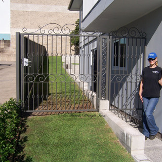 """Contemporary' laneway access gates. (front-view.)"