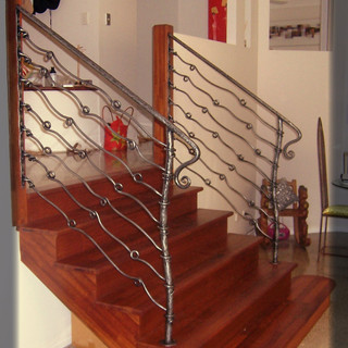 """""""Free form"""" wrought iron balustrade side view."""
