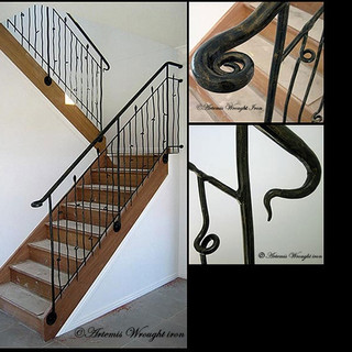 """""""Free Form"""" wrought iron balustrade features horizontally scrolled newell post and vertical pickets."""