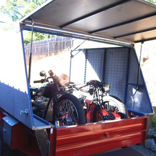 Full access to front of trailer with high quality gas strut assisted door. (see next image).