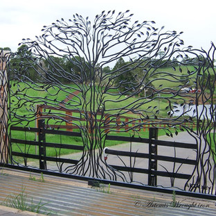 """The """"Freedom Fig""""  Featuring 229 hammered and forged leaves and limbs, with rustic fence posts, railings and blade grass."""
