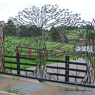 "The ""Freedom Fig""  Featuring 229 hammered and forged leaves and limbs, with rustic fence posts, railings and blade grass."
