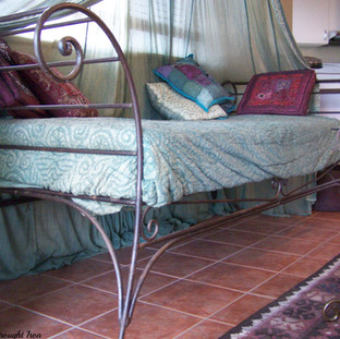 """""""Snoozer"""" A simple elegant hancrafted king single daybed with large flowing end scrolls."""