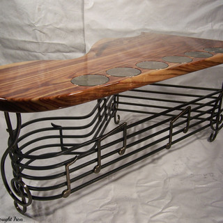 """""""Guitar hero""""  Coffee table  Features a """"Bass clef"""" and music stave frame including crochets and quavers, swirl polished """"machine heads"""" and a solid Camphor laurel"""" top."""