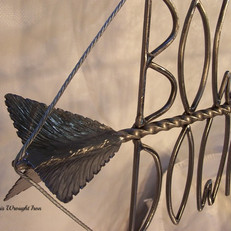 """Bowhunting Down Under"" Wrought iron signage. (close-up detail.)"