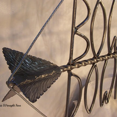 """""""Bowhunting Down Under"""" Wrought iron signage. (close-up detail.)"""