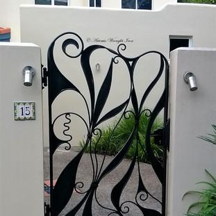 Free Style Wrought Iron Pedestrian gate.