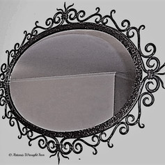 """""""Medusa"""" A commissioned wrought iron oval mirror frame."""