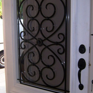 An elegantly styled wrought iron window security grill.