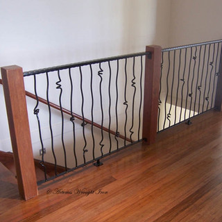 """""""Free form"""" balustrade featuring hammered square top rails."""