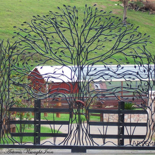 """The """"Freedom Reprise"""" Featuring 210 hand forged leaves, hammered rustic fence posts and railings and plant forms."""