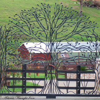 "The ""Freedom Reprise"" Featuring 210 hand forged leaves, hammered rustic fence posts and railings and plant forms."