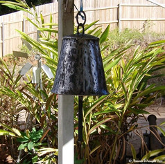 """Wrought iron dinner bell"""
