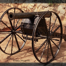 """Gettysburg"". A replica 19th century civil war canon. Featuring a hand beaten rolled barrell, adjustable trajectory, fully fabricated body, with heavy duty wrought iron wheels and spokes."