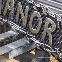 """""""Widney Manor"""" Wrought iron signage. (close-up detail.)"""