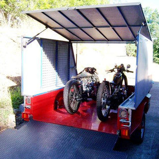 Gas assisted roof raises for easy ride-in loading. Easily accommodates 2  bikes with side mesh for hanging accessories and straps.