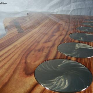 """Guitar hero""  Coffee table close-up detail of swirl polished machine heads."