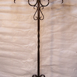 A large freestanding wrought iron candleabra to hold 5 large candles.