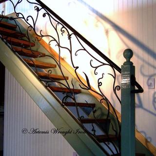 """Sweeping vine"" balustrade."