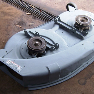 Ride on mower slasher body rust repair and strengthening.