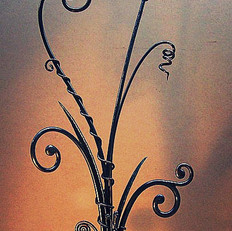 """Springtime"" Wrought iron sculpture. Features forged scrolls with closed ends, texturing, forged leaves, and vines."