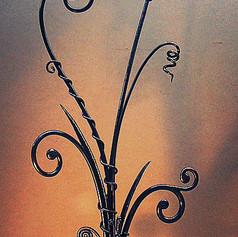 """""""Springtime"""" Wrought iron sculpture. Features forged scrolls with closed ends, texturing, forged leaves, and vines."""