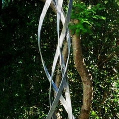 """""""Eternal flame"""" Wrought iron garden art sculpture, made with forged solid flat bars, curved to resemble a fires flame."""