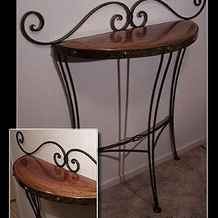"""""""Taurus""""  Hall table Features fine ironwork with a red cedar top."""
