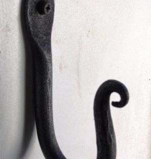 Wrought iron wall hooks.