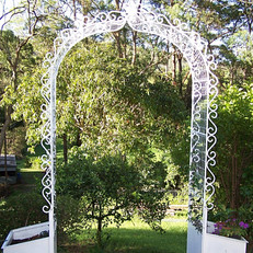 """Vintage garden arbor"" Features vintage style scrollwork and one-piece planter boxes."