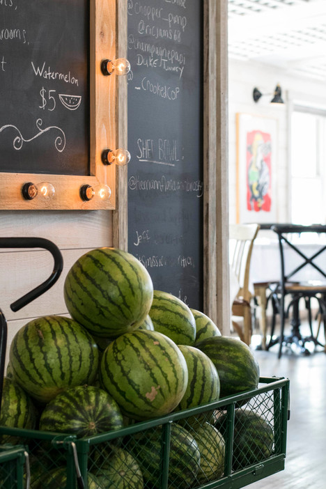 Watermelon wagon in front of sign.jpg