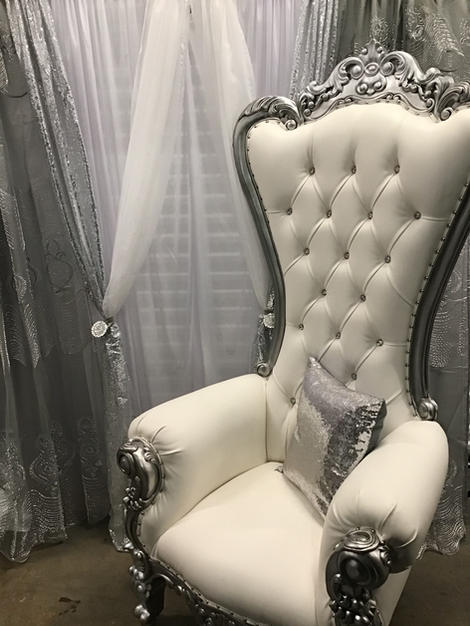white silver throne chair with backdrop
