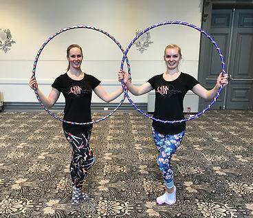 Circus trainers Hannah and Kate teaching hula hoops