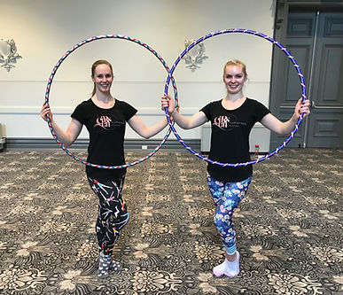 Circus trainers Hannah and Kate teaching hula hoops