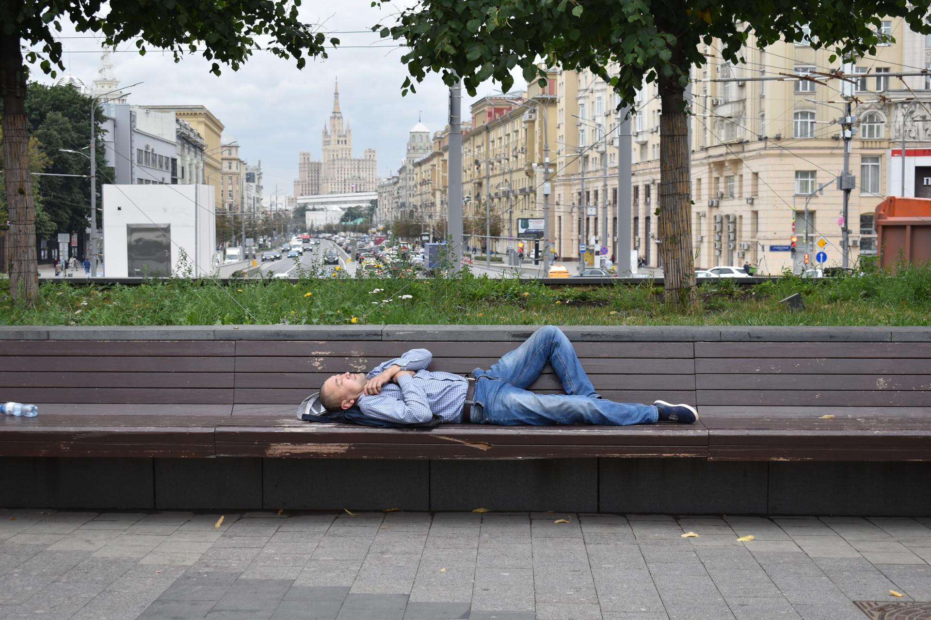 a Man Sleeps in Triumfalnaya Square.